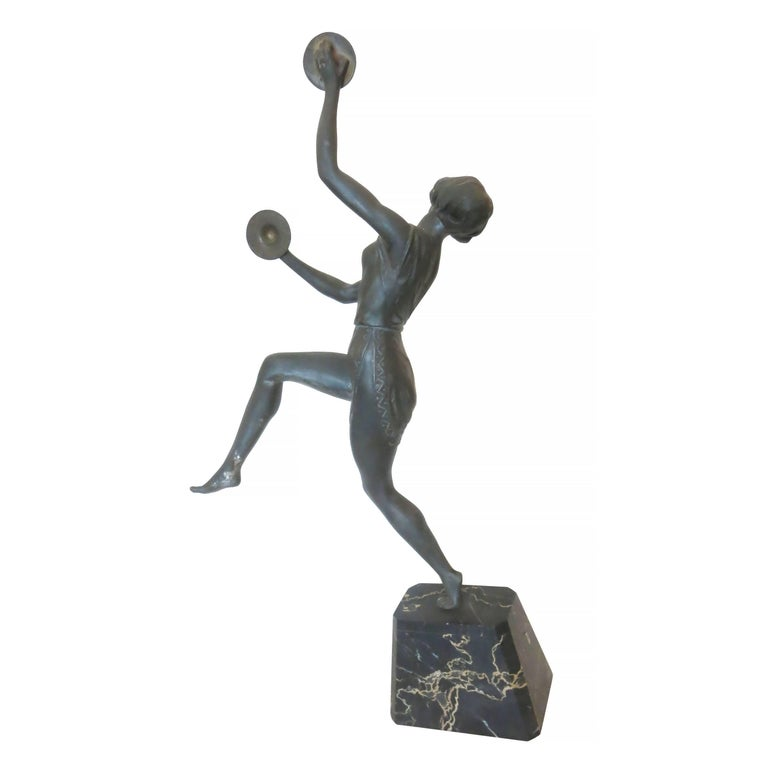 Art Deco style bronze figural statue of a dancer with cymbals fashioned after the works of Lucien Alliot. The statue features an antique patina finish and stands on a marble base.   Product handcrafted in the USA with the highest quality