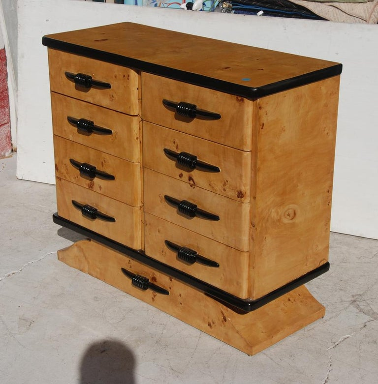 Beautiful dresser in exotic burl with deco pulls.