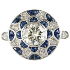 Art Deco Style Calibrated Sapphire Diamonds 18 Karat White Gold Round Shape Ring