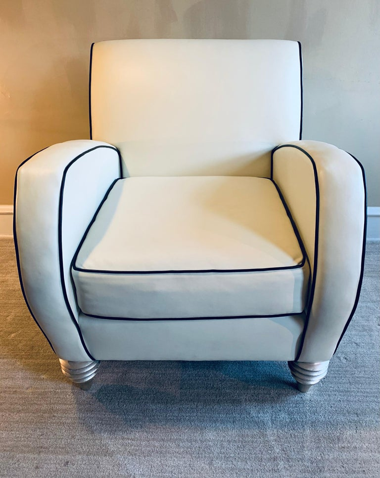 The most buttery leather club chair in ivory leather with black leather piping.   Nary a child nor a pet has ever come close to this piece. It's truly pristine.   Additionally, it's amazingly comfortable.