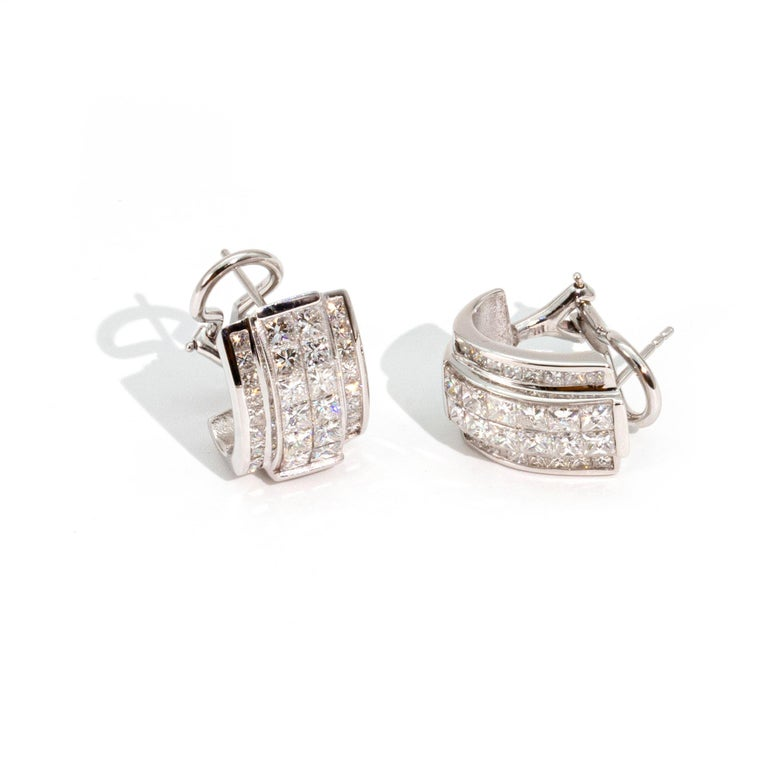 These ultimate and extremely versatile Art Deco Style Diamond and 14 Carat White Gold Earrings have both style and substance. With the appearance of a clip on earring, this design is timeless in that it could be 80s/90s style also.   Casual enough