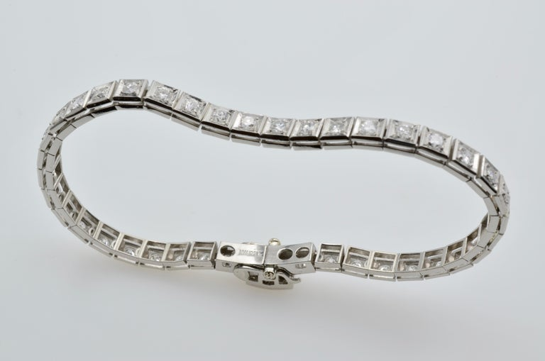 This stunning sparkler is reminiscent of the roaring 20's. Wear it alone or layer with other bracelets and a watch. The style is classic and a piece of jewelry you will wear and cherish for years to come. The diamonds are bright white and 2.05 tw.