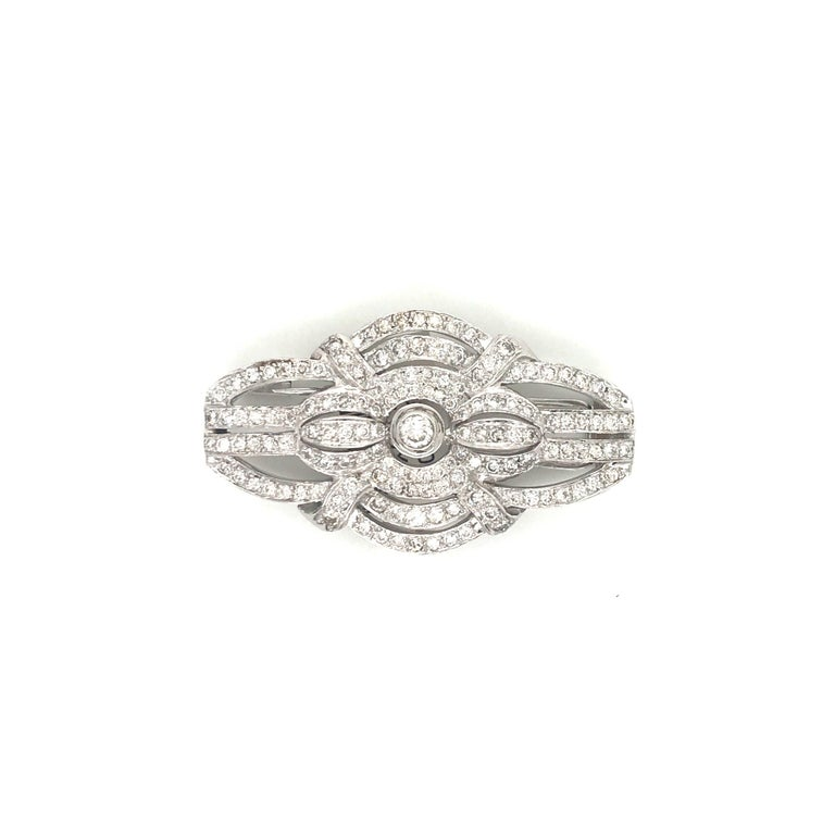 Stamped Italy 18K, this Art Deco inspired brooch features numerous round brilliants weighing 2.50 carats. Color H Clarity SI