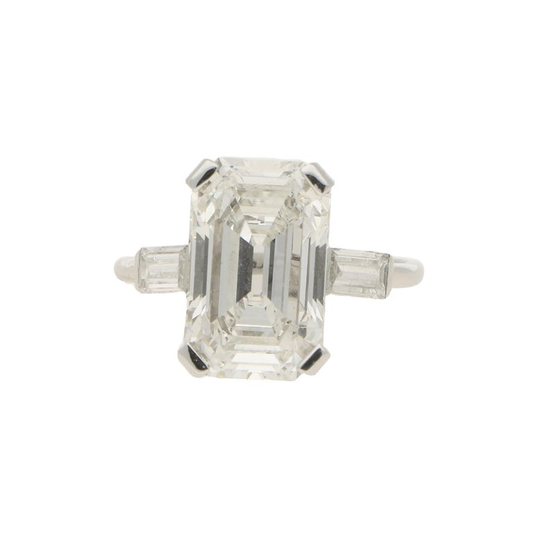 A simply beautiful Art Deco Style cut cornered rectangular step cut diamond engagement ring, set in platinum. This stunning central stone is GIA certified as a 3.75 carat diamond, assessed as F colour and VVS2 clarity - spectacular specifications