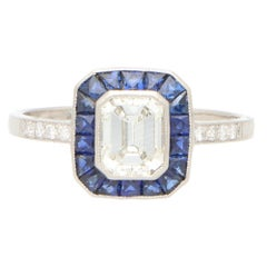 Art Deco Style Emerald Cut Diamond and Sapphire Halo Engagement Ring in Platinum