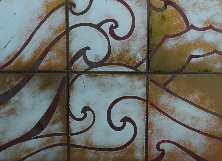 Art Deco style enameled sheet metal tile on panel wall hanging comprised of 15 tiles with wave pattern. Measures: 48