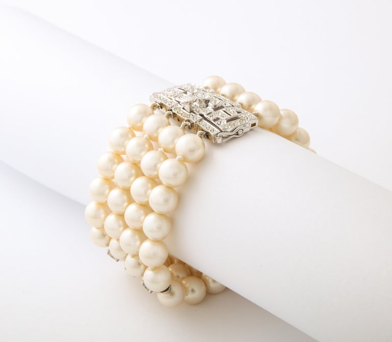Art Deco Style Faux Diamond Sterling Japanese Four Strand Glass 10mm Pearl Bracelet 7.5 inches long by 1.75 inches wide. Hand silk knotted