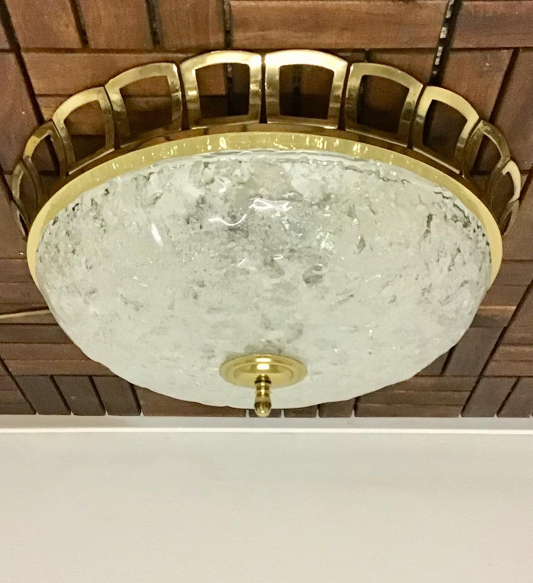 Glass and brass flush mount in the style of Art Deco.