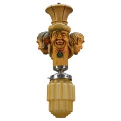Art Deco Style Hand-Carved Wooden and Crackle Glass Pendant Light Three Men Head