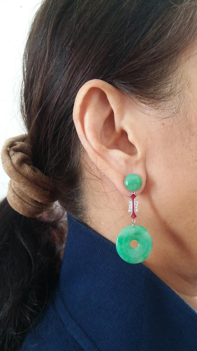 We have 2 round jade buttons on top , the central part are composed by 2 elements in gold , diamonds and  red enamel , in the bottom part we have 2 jade Donuts In 1978 our workshop started in Italy to make simple-chic Art Deco style jewellery,