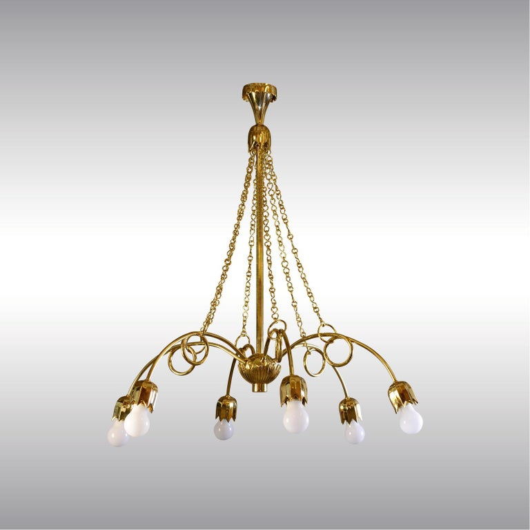 A really beautiful, modern and exclusivebrass chandelier, chased, hammered and casted parts. Model# 3669-M and WWF 119-4-2 at the Wiener Werkstätte pattern-book at the MAK, Museum of Applied Arts Vienna. The historical image shows a Wiener
