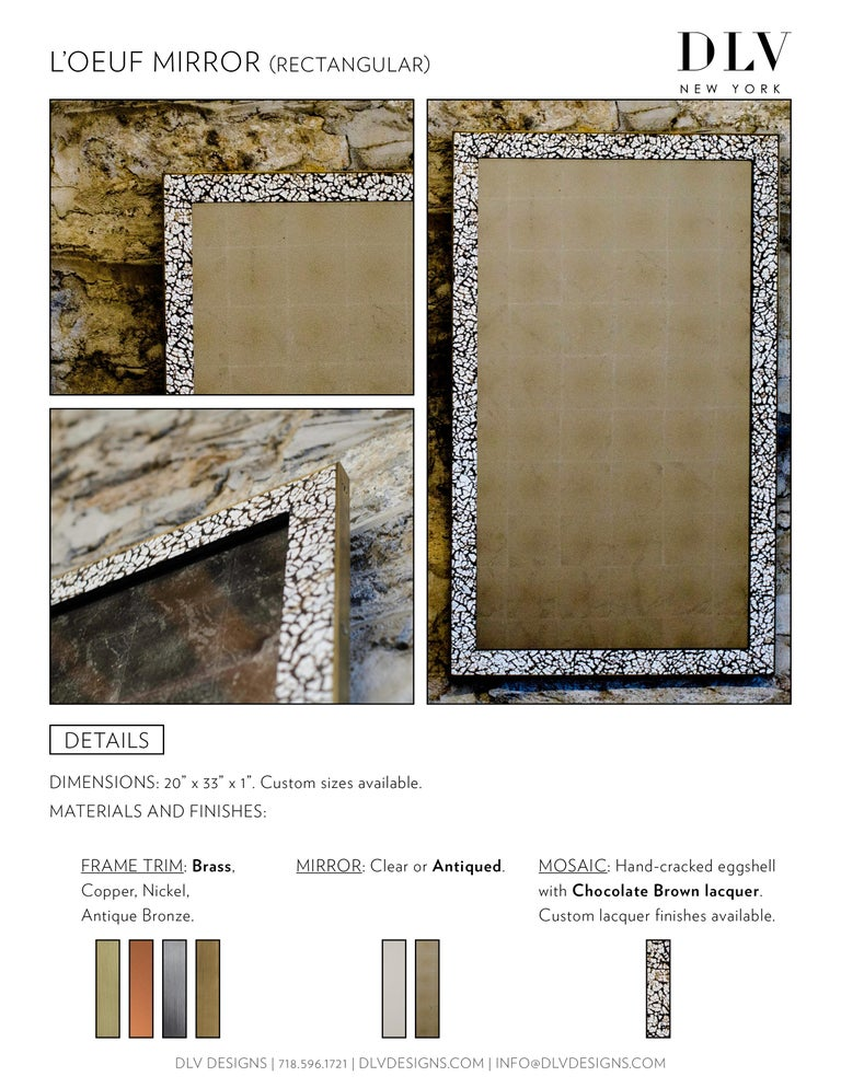 Hand-cracked eggshell and lacquer frame, trimmed in brass or antique bronze. Églomisé mirror available.