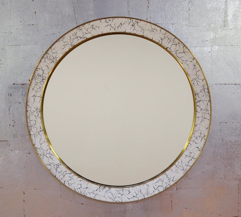 Hand-cracked eggshell and lacquer frame, trimmed in brass or antique bronze. Eglomisé mirror available. Dimensions: 48