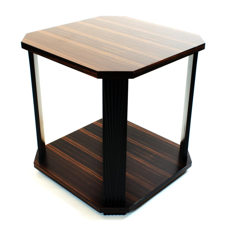 Art Deco inspired side table in genuine Ebony Macassar veneer. This reiteration of a classic design from 1930s is available in various exotic veneers and finishes with fully customizable size to complement your interiors. Minimalistic shape of the