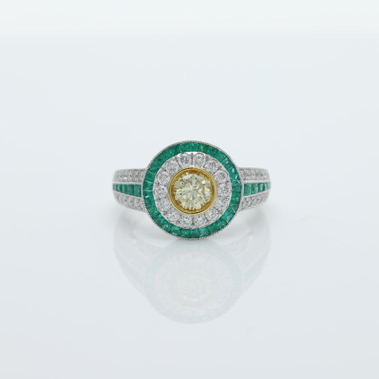 Art Deco Style Colorful Ring - Impressive and Bold Center is Diamond surrounded with Green Emeralds, sides have also Emerald and Diamonds All stones are Natural 18k White Gold 7.30 grams Center Diamond size - 0.58 carat (6 mm) Round Shape Brilliant