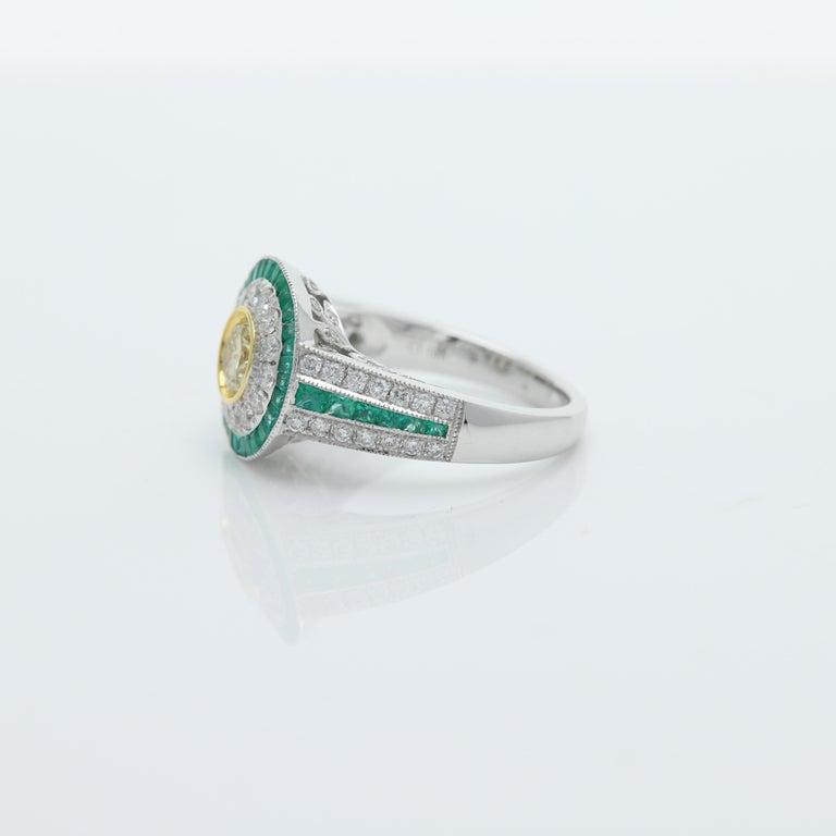 Women's Art Deco Style Ring Emerald and Diamonds 18 Karat White Gold and Yellow Diamond For Sale