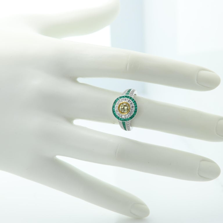 Art Deco Style Ring Emerald and Diamonds 18 Karat White Gold and Yellow Diamond For Sale 1