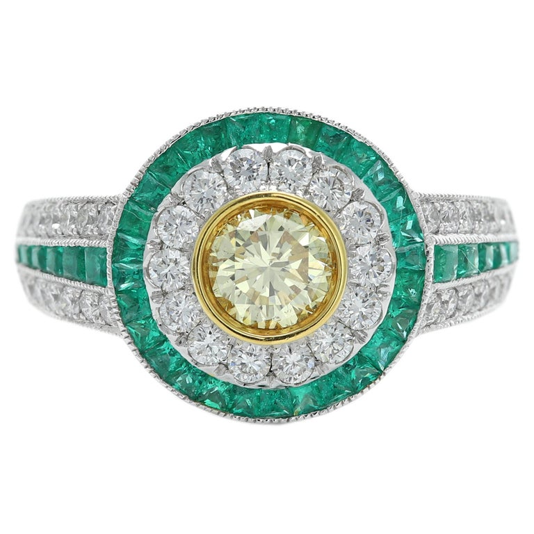 Art Deco Style Ring Emerald and Diamonds 18 Karat White Gold and Yellow Diamond For Sale