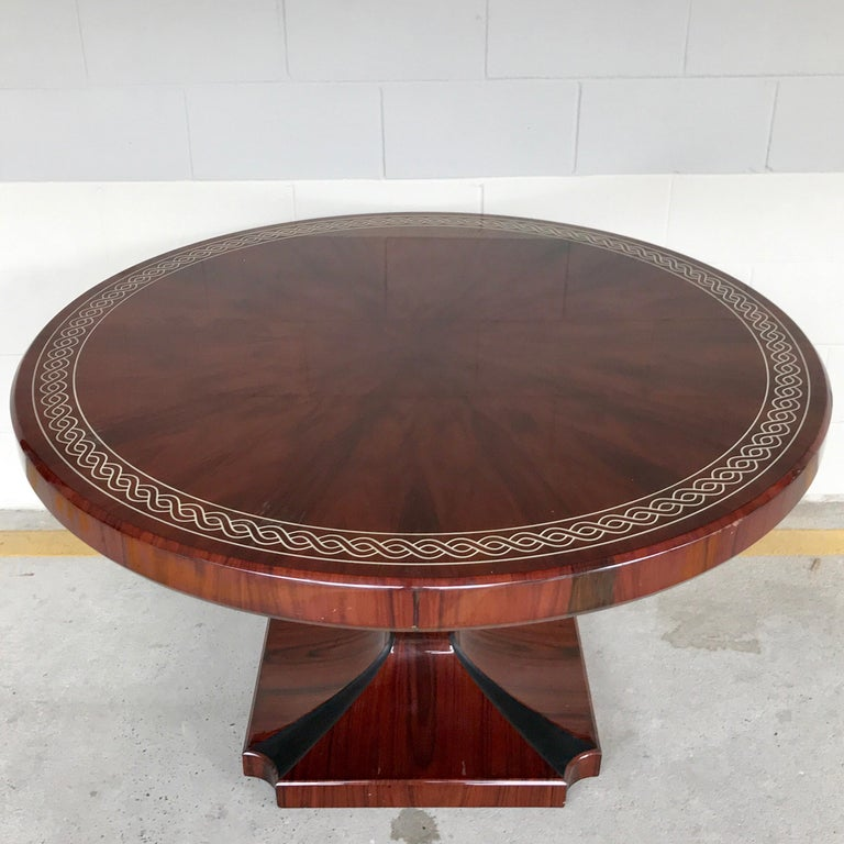 Art Deco style rosewood centre table with lacquer inlay, the circular top raised on a tapered urn pedestal base with inlaid ebony. Constructed in two pieces, the top is removable for shipping.