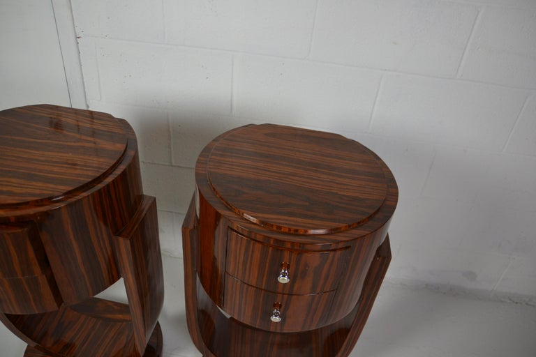 Pair of two drawers rosewood Art Deco style nightstands or end tables.
