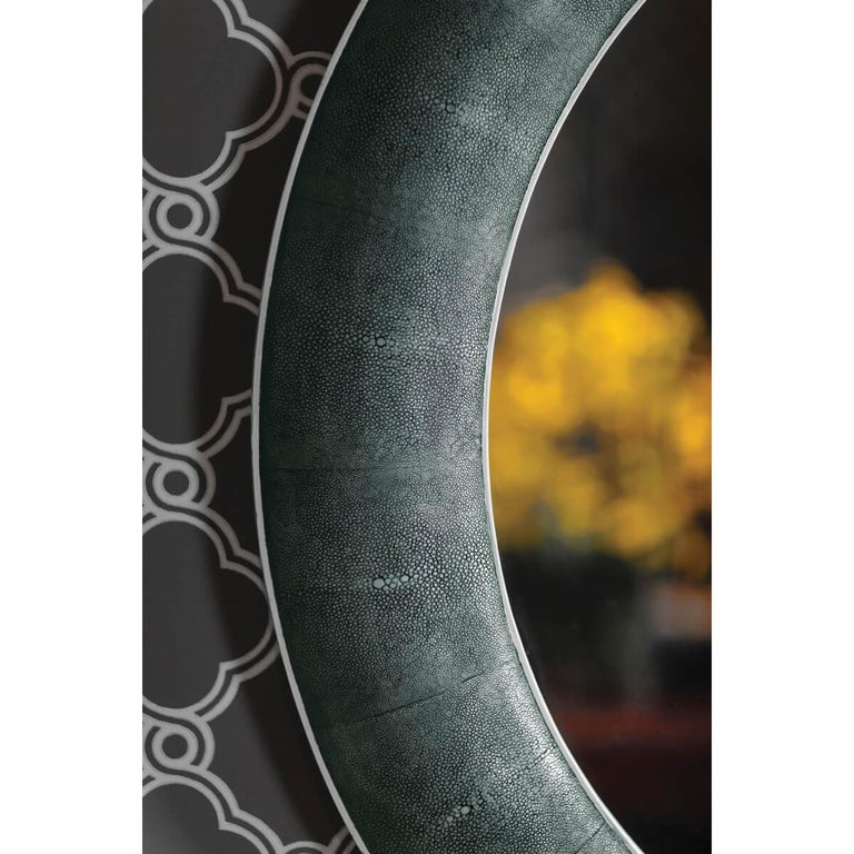 Large Art Deco style circular mirror with concave moulding veneered with faux shagreen and with a black rub-through faded finish. Plain mirrored glass.  Dimensions: 45.5