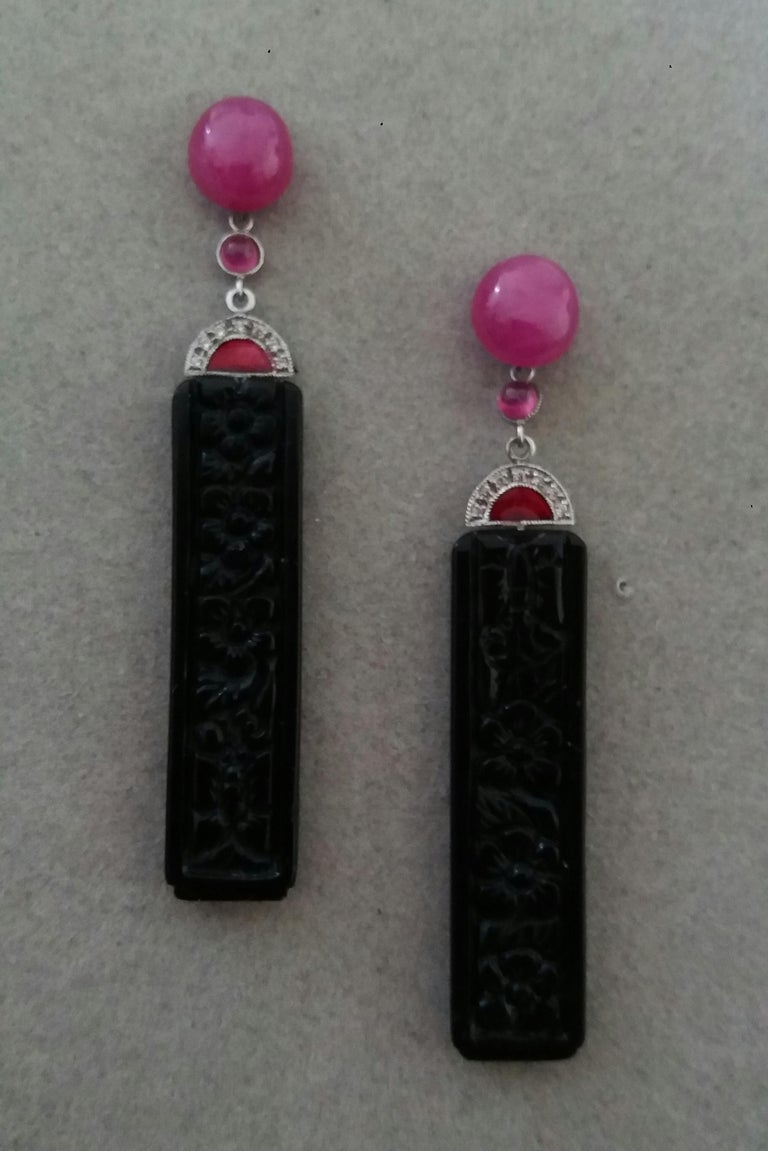 2 Oval Ruby cabs are on top, middle parts  with small Ruby round cabochons, white gold ,14 round full cut diamonds,red enamel,in the bottom parts we have 2 Carved Black Onyx   rectangular bars measuring 10 x 40 mm.  In 1978 our workshop started in