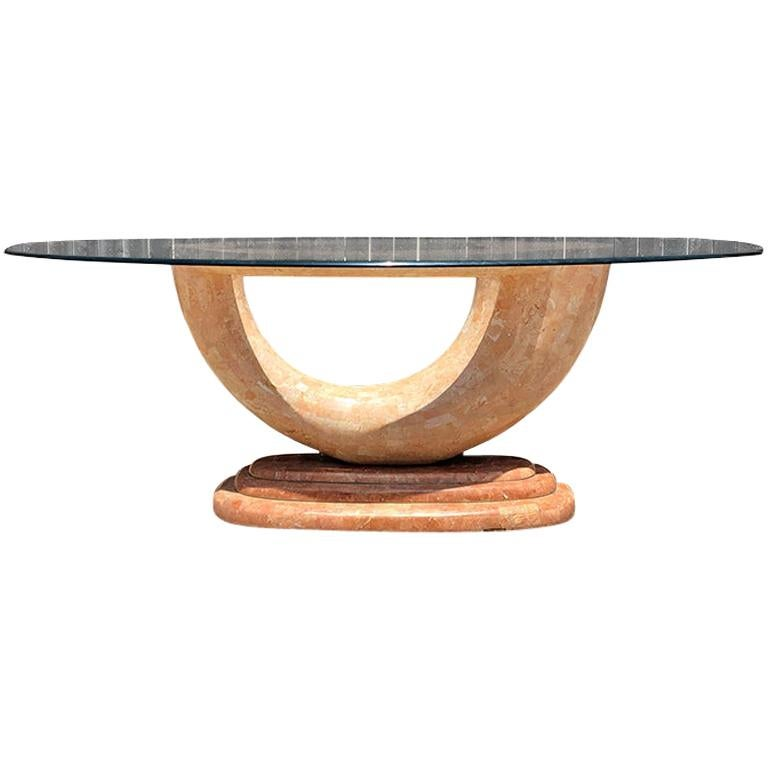 Pink Marble Serpentine dining table with oval glass top and sculptural waterfall base attributed to Karl Springer. Rare art deco or art nouveau mid-century modern pink laminate tessellated marble base shaped in a wonderful curved shape.   The base