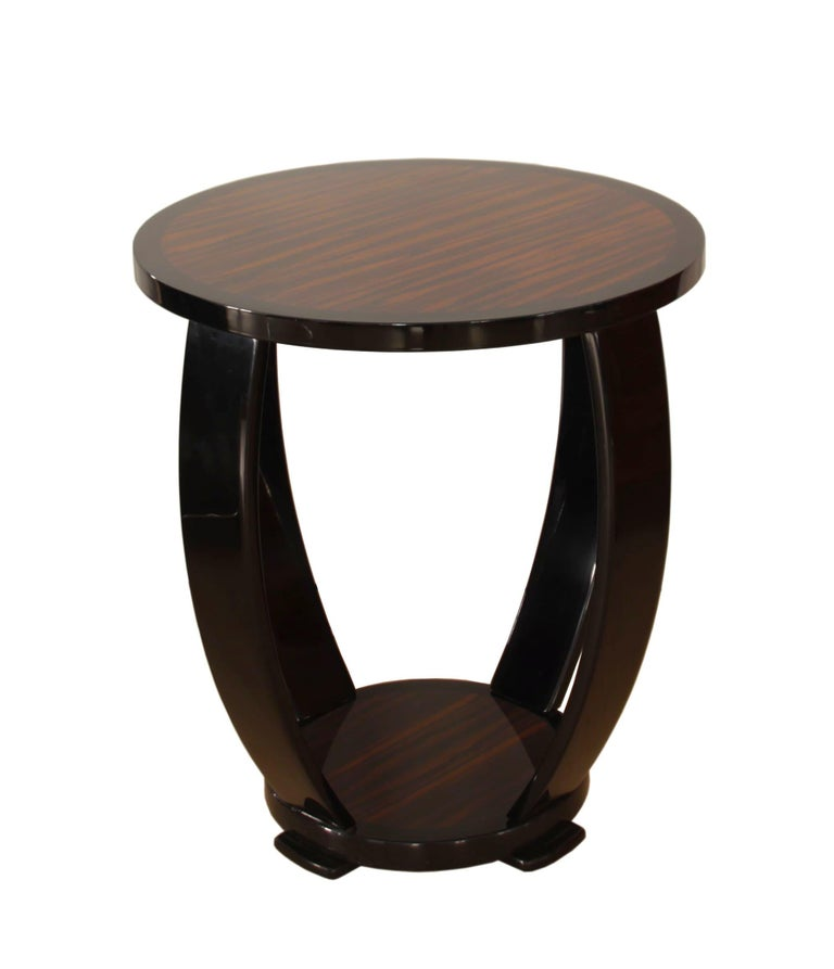 Elegant and Classic French Art Deco style side table or Guéridon.  Plates veneered in Macassar. Side bolsters ebonized / black lacquered. Amazing hard Polyester piano lacquer, polished.  Handcrafted after original design, built in South