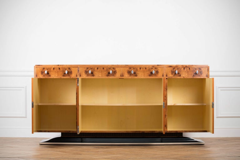 Art Deco style sideboard labelled by Restall Brown and Clenel, late 20th century in date. Art Deco is a style of visual arts, architecture and design that first appeared in France just before World War I. It combined modernist styles with fine