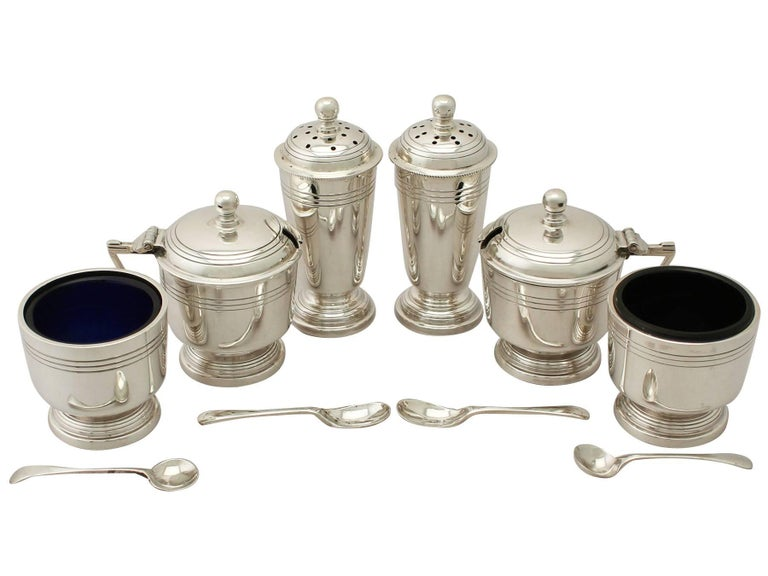 An exceptional, fine and impressive vintage Elizabeth II English sterling silver six-piece condiment set in the Art Deco style - boxed; an addition to our dining silverware collection.  This exceptional vintage Elizabeth II sterling silver six