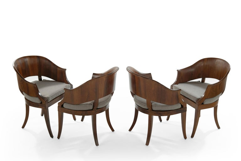Set of four art deco style hand sculptured walnut armchairs. Walnut fully restored, newly linen upholstered cushions.