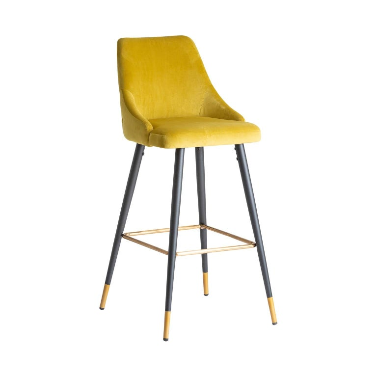 Art Deco style bar stool with a black laquered metal feet with gilded metal finish and a comfortable mustard velvet seat padded back. Elegant, aerial and poetic.