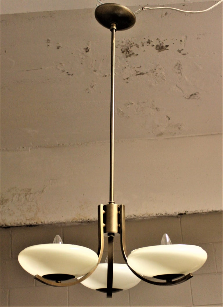 American Art Deco Styled Brass Three Branch Chandelier with Off-White Glass Cupped Shades For Sale