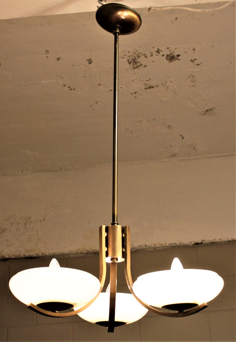 Machine-Made Art Deco Styled Brass Three Branch Chandelier with Off-White Glass Cupped Shades For Sale