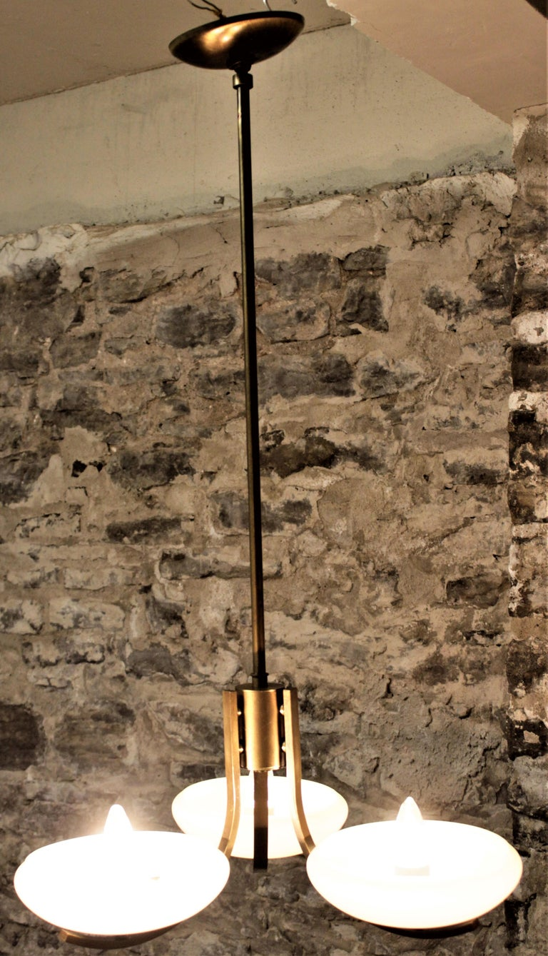 20th Century Art Deco Styled Brass Three Branch Chandelier with Off-White Glass Cupped Shades For Sale