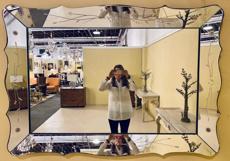 Art Deco styled over the mantel (fireplace) or wall or console mirror. This large and impressive shadowbox frame mirror with etched panels is simply stunning with its curved etched glass sides. This mirror can easily mount to the wall vertically or