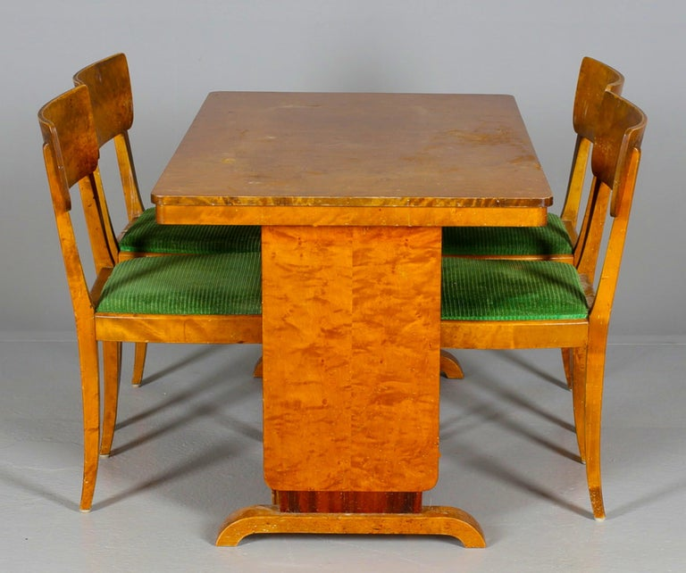 Very unusual original Swedish Art Deco set of 4 dining chairs in a highly French polished finish with lovely detail.  Measure: Approx 45cm wide x 40cm deep x 81cm tall approx  They have stunning golden birch veneers in the desirable honey