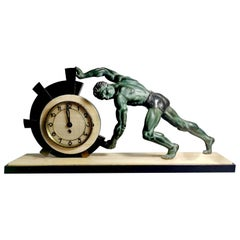 Art Deco Table Clock with Huge Bronze Statue, France, 1930