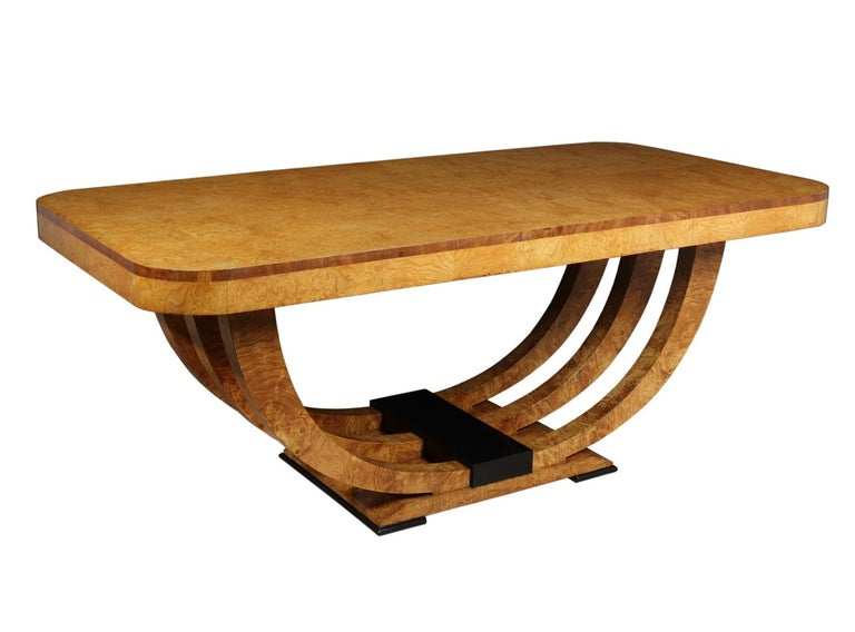 Art Deco Table in burr elm French, circa 1930 A rare French Art Deco dining table with a triple u base in burr elm, lovely quality and fully restored and professionally hand polished excellent condition throughout  Age: 1930  Style: Art