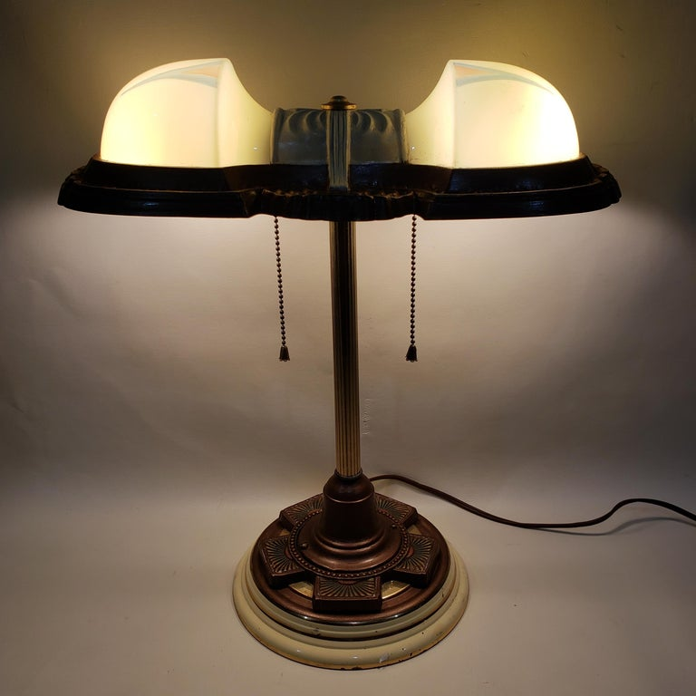 Two light Art Deco table lamp with light mint green shades and a decorative metal base.