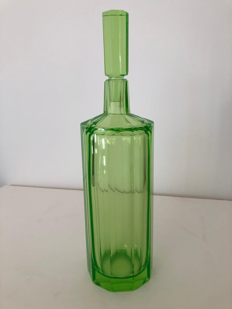 Art Deco tall slender Vaseline glass Moser style unsigned faceted panel decanter / large cologne bottle, with elegant stopper.