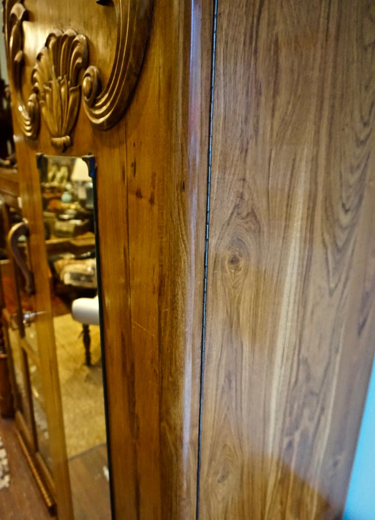 Mid-20th Century Art Deco Teak Armoire with Lotus Motif For Sale