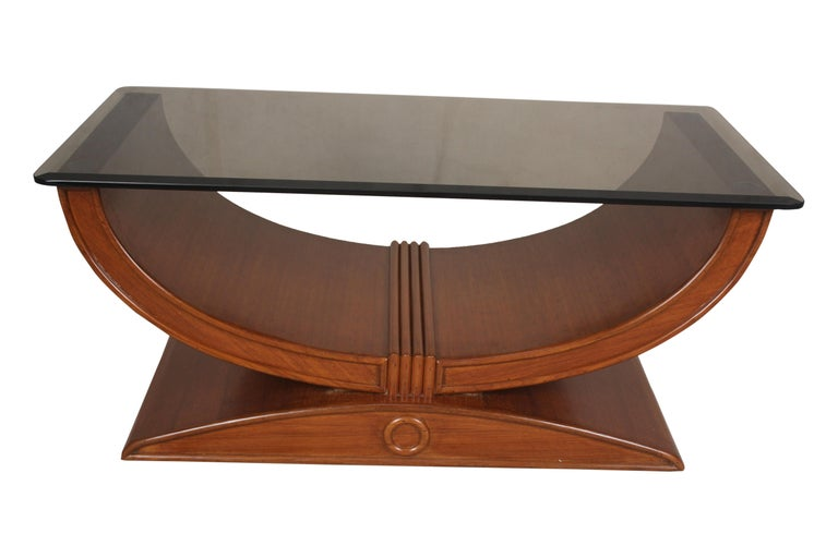 An outstanding U-shaped teak wood cocktail or coffee table from the Art Deco period. Features a beveled, smoked glass top. The generous size could also make a great console table or credenza for a flat screen television. European.
