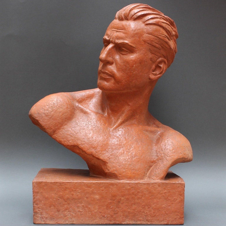 Art Deco terracotta sculpture bust of stylized man by Demétre H. Chiparus (circa 1930s). Art Deco was the expression of a desire to be modern. It featured rare and expensive materials and exquisite craftsmanship. Chiparus was inspired in his work by