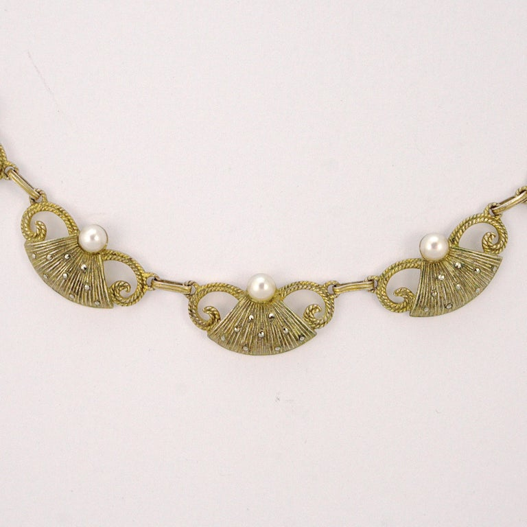 Superb Art Deco Theodor Fahrner sterling silver gilt textured necklace, designed with five beautiful links embellished with marcasites and cream cultured pearls, and a rectangular link chain with marcasites. The back is smooth. Measuring length