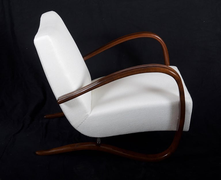 Beech bentwood walnut stained armchair made by Thonet in the 1930s. Excellent restored with seat springs upholstered with Lelievre wool fabric. Another fabric and wood finish on request possible On request several available Delivery time about