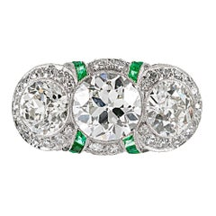 Art Deco Three-Stone Diamond Ring with Emeralds