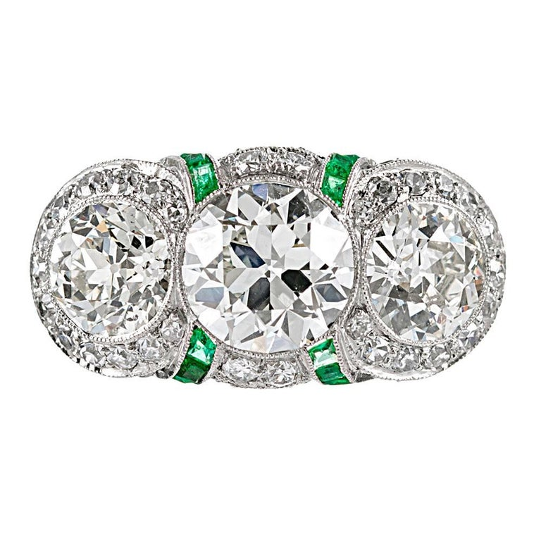 Art Deco Three-Stone Diamond Ring with Emeralds For Sale