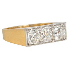 Art Deco Three-Stone Old Mine Cut Diamond, Gold, and Platinum Band-Style Ring