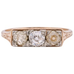 Art Deco Two-Tone 14K Yellow Gold and 18K White Gold .95 Carat Three-Stone Ring